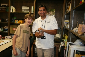 Joe and FWNC&R naturalist Mike Perez with a baby alligator. Alligators NEVER make good pets. This snappy friend is only used for educational and research purposes.